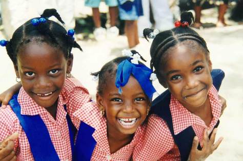 three-girls-smiling-in-school-uniform-barrett-town-jamaica-4268-opt-800x533
